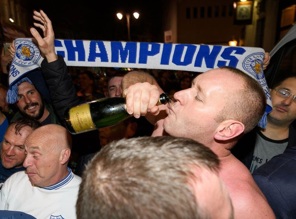 Leicester fans celebrate the club's Premier League success on Monday night