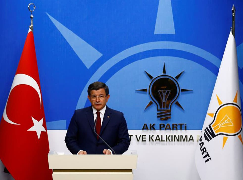 Ahmet Davutoglu speaks during a news conference in Ankara