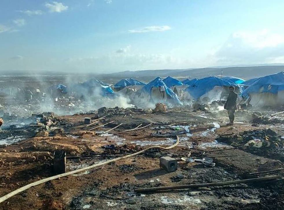 The scene shortly after the air strike on Thursday afternoon in Sarmada, near the border with Turkey