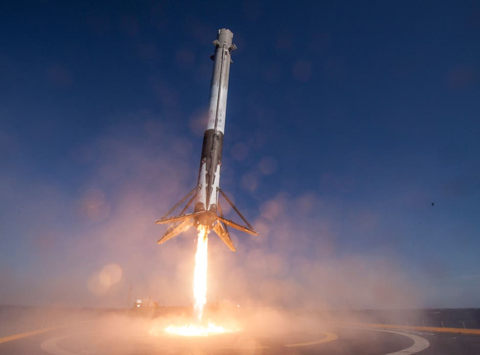 A Falcon 9 rocket touches down at sea in April's first successful landing