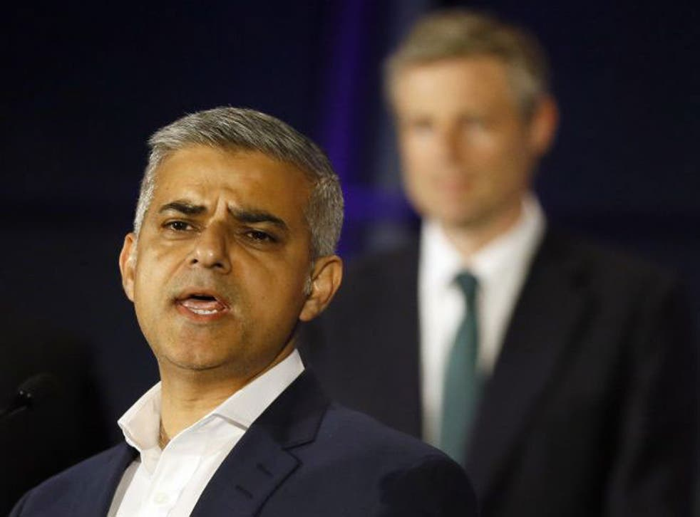 """Zac Goldsmith listens at City Hall as Sadiq Khan gives his victory speech, calling for """"hope over fear and unity over division"""""""