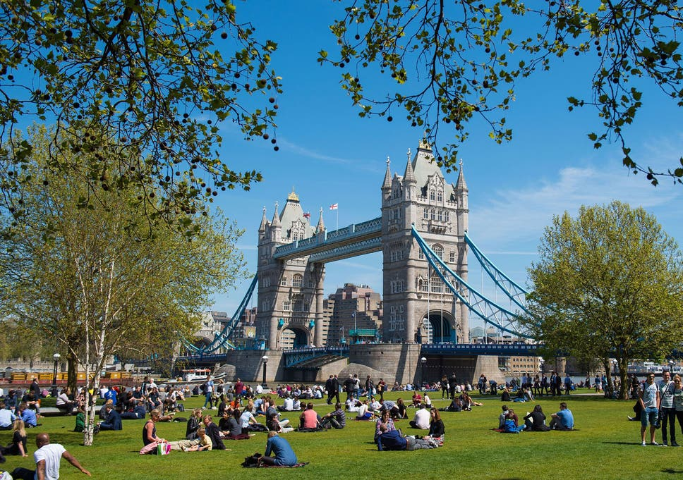 People Enjoy The Sun In Potters Fields In London As Many Parts Of The Uk