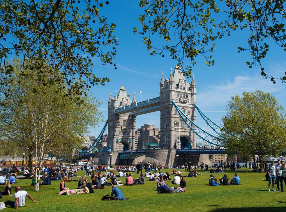 People enjoy the sun in Potters Fields in London, as many parts of the UK enjoy a day of warm weather