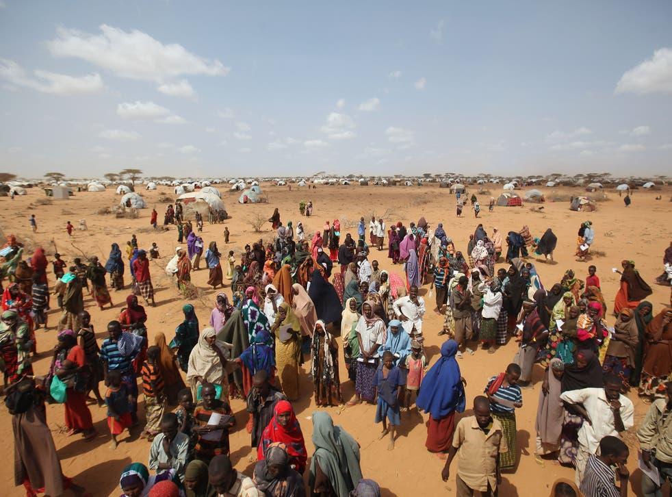 Somalian refugees queue for tents at Kenya's Dadaab refugee camp