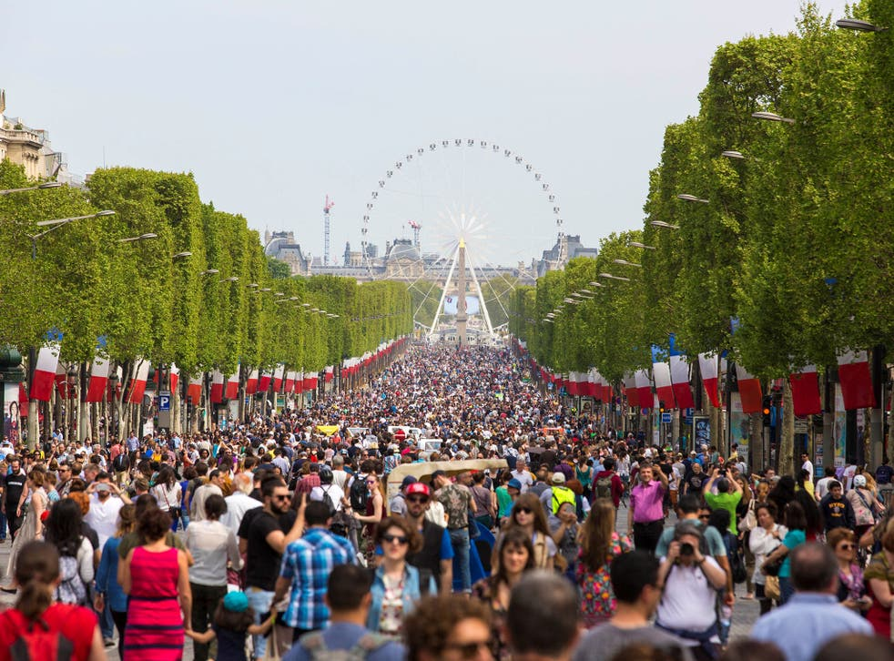 People gather on the Champs-Elysees boulevard in Paris