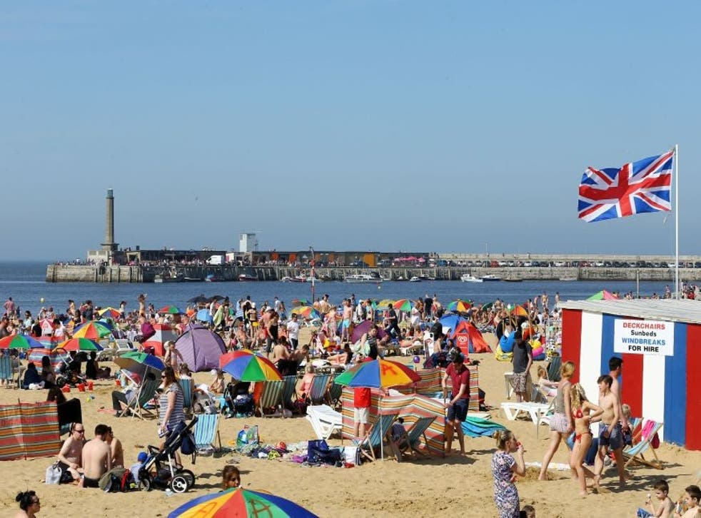 People making the most of the sunshine in Margate, Kent as temperatures reach the high 20s in southern England