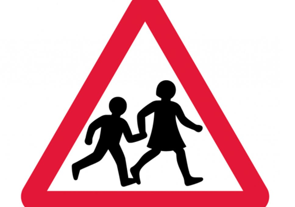 iconic british road sign of two schoolchildren crossing updated by