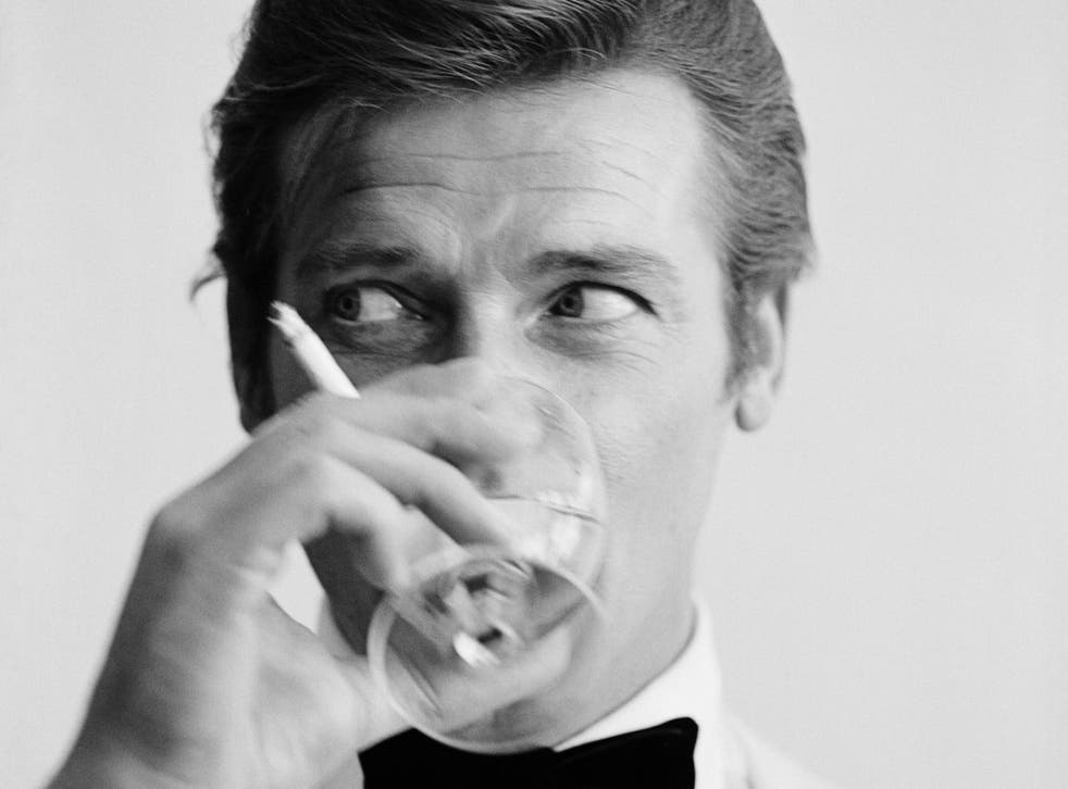 Roger Moore enjoys a cigarette and a martini during a 1968 photoshoot