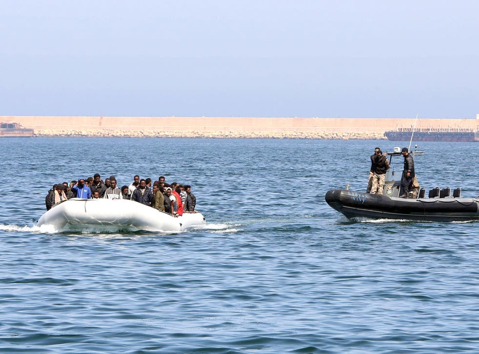 Libyan coast guards chase down a boat of illegal migrants bound for the Italian island of Lampedusa