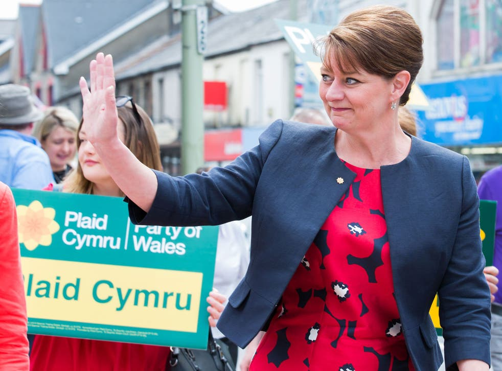 Residents of the town of Treorchy congratulate Leanne Wood after she seized the Rhondda seat from Labour in the Welsh Assembly