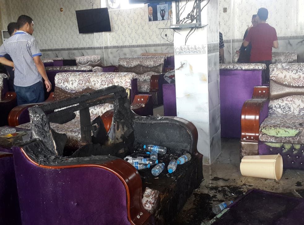 Damage inside a cafe after an attack in the predominately Shia Muslim city of Balad, Iraq, May 13 2016.