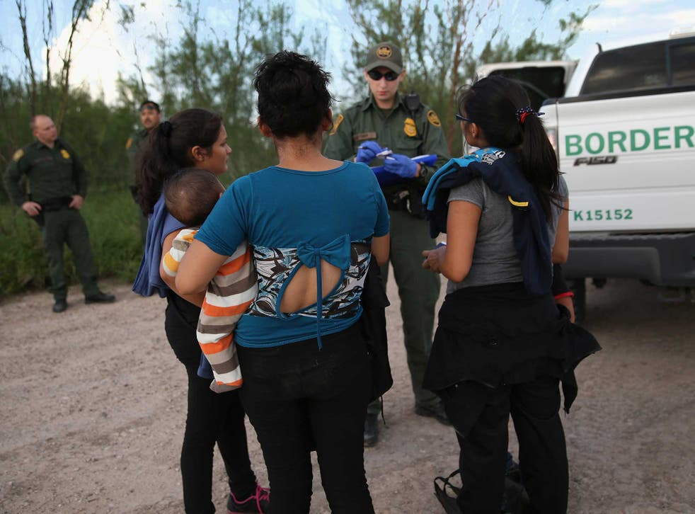 Immigrants from central America turn themselves in to US Border Patrol agents after crossing the Rio Grande River from Mexico