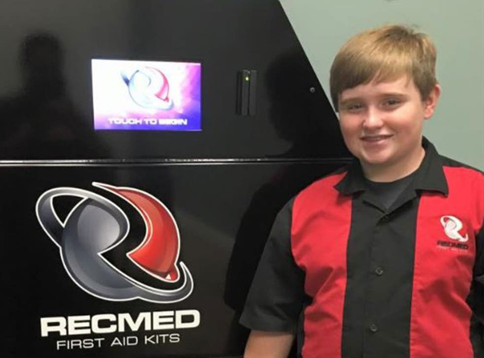 Taylor Rosenthal, 14, demonstrates one of his RecMed first aid vending machines