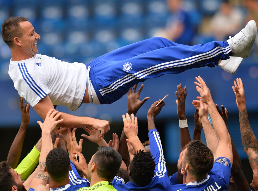 John Terry is given the bumps by his team-mates at Stamford Bridge on Sunday