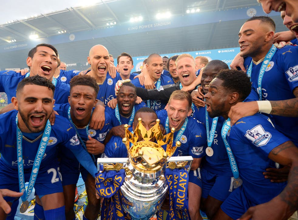 Leicester City celebrate with the Premier League trophy