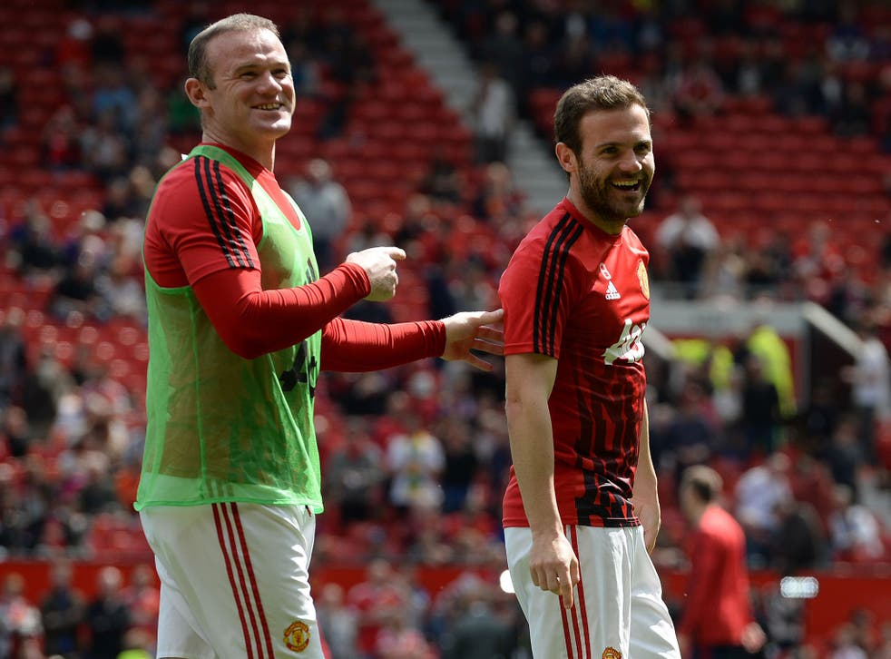 Juan Mata with Wayne Rooney just before the scare at Old Trafford