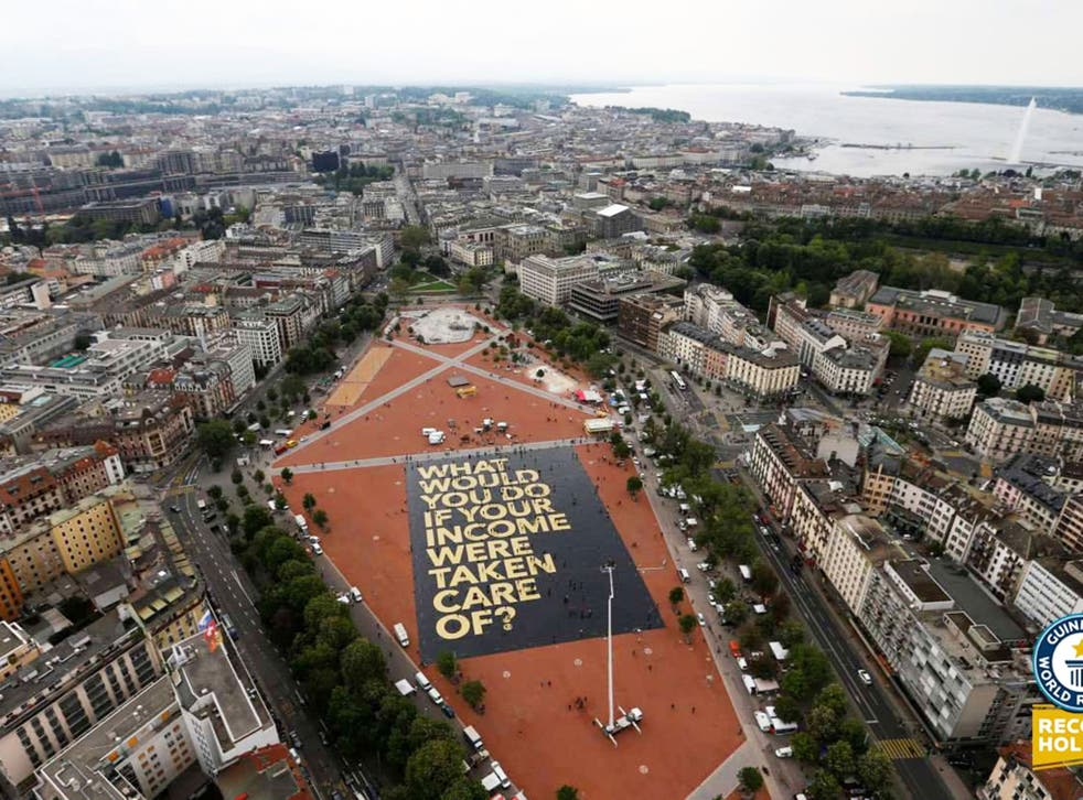 Activists in Switzerland set a Guinness world record for the largest campaign poser as the country prepares to vote on proposals to introduce a universal basic income