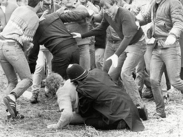 A police officer wrestles a miner to the ground during the 'Battle of Orgreave'
