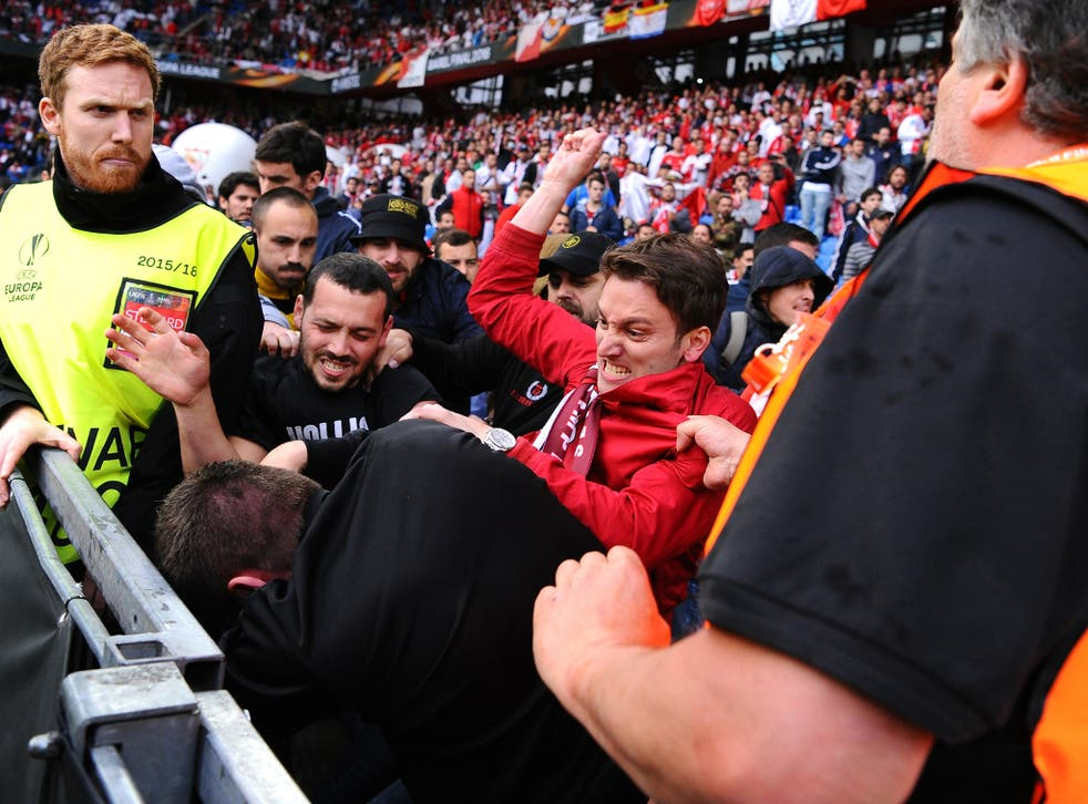 Fans scuffle prior to the UEFA Europa League Final match between Liverpool and Sevilla at St. Jakob-Park