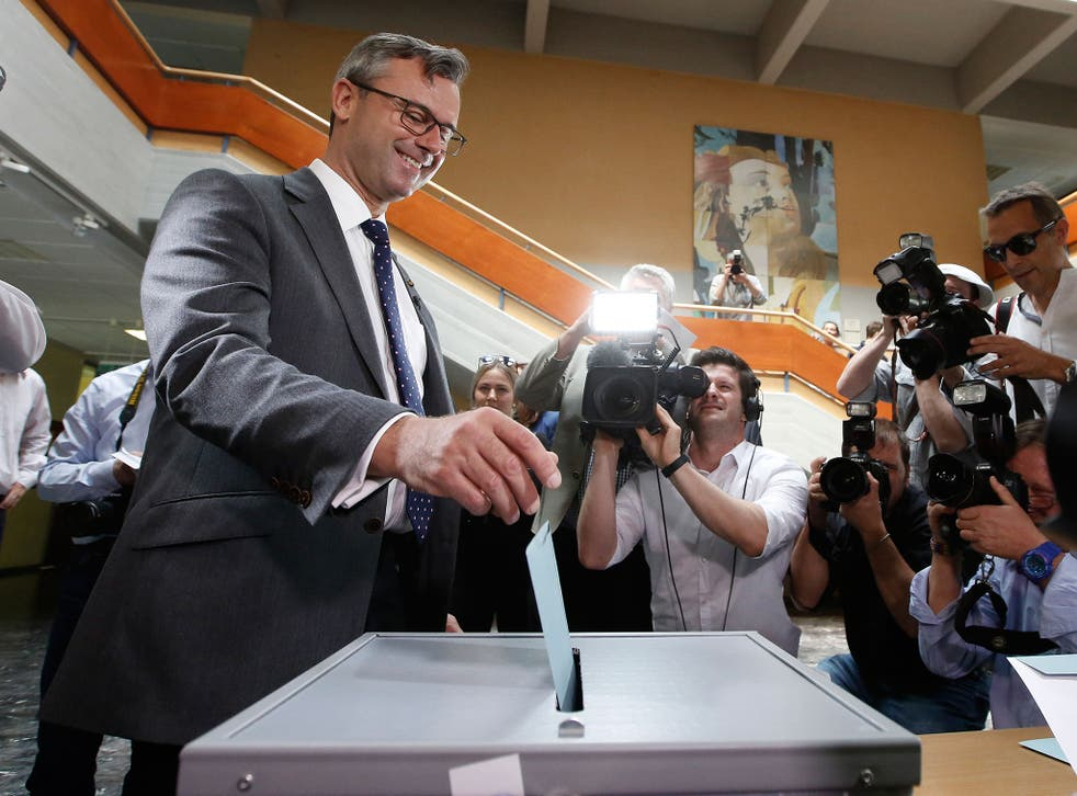 Austrian Freedom Party candidate Norbert Hofer drops his ballot during the second round of Austrian President elections