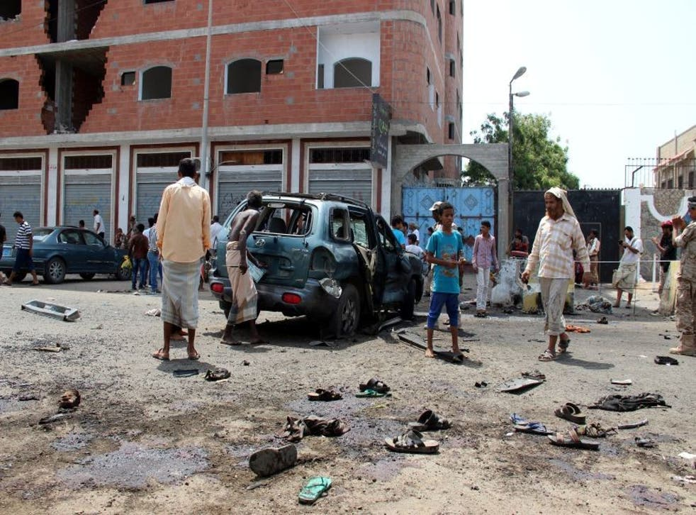The aftermath of the twin suicide attacks which killed 45 people in the Yemeni port city of Aden