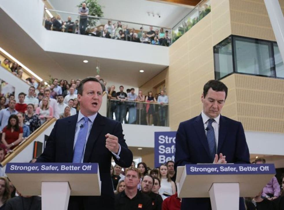 Chancellor George Osborne listens as Prime Minister David Cameron delivers a speech on the economic impact of the UK leaving the European Union at B&Q headquarters in Chandler's Ford, Hampshire, Monday 23 May, 2016