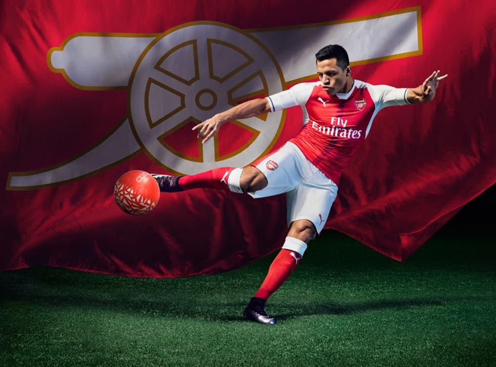 Alexis Sanchez models the new Arsenal shirt