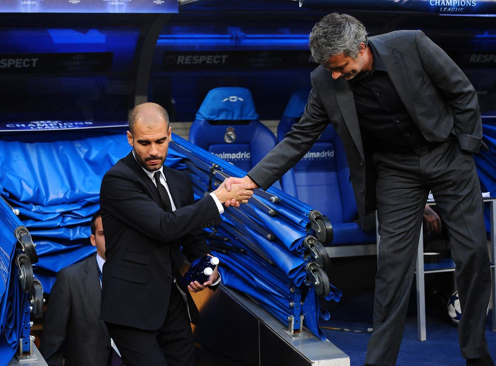 Barcelona's Pep Guardiola and Real's Jose Mourinho shake hands during their at times bitter rivalry in Spain