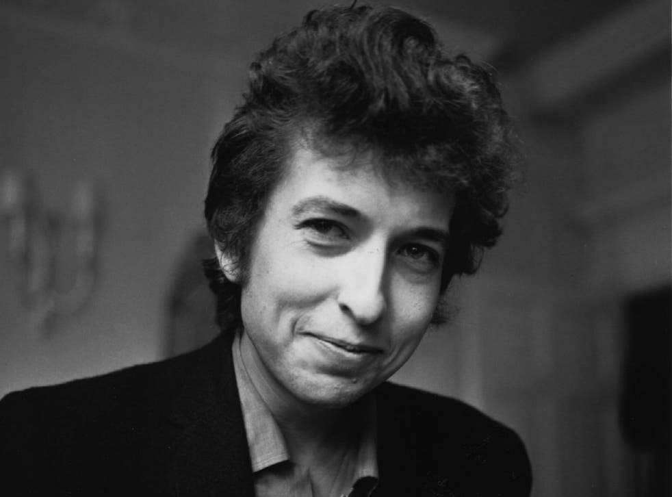 Bob Dylan in 1985 giving a rare smile in a photograph (Getty Images)