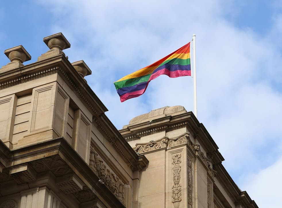 A rainbow flag is seen above Parliament House as Premier Daniel Andrews makes an apology to the Victorian Gay community