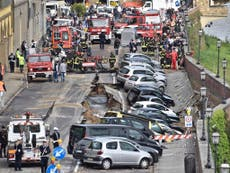 Florence sinkhole: Cars swallowed after stretch of road collapses