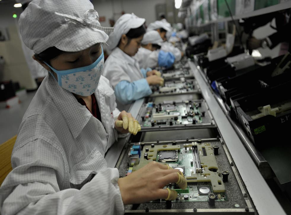 Workers assemble components at the Foxconn factory in Shenzen, China