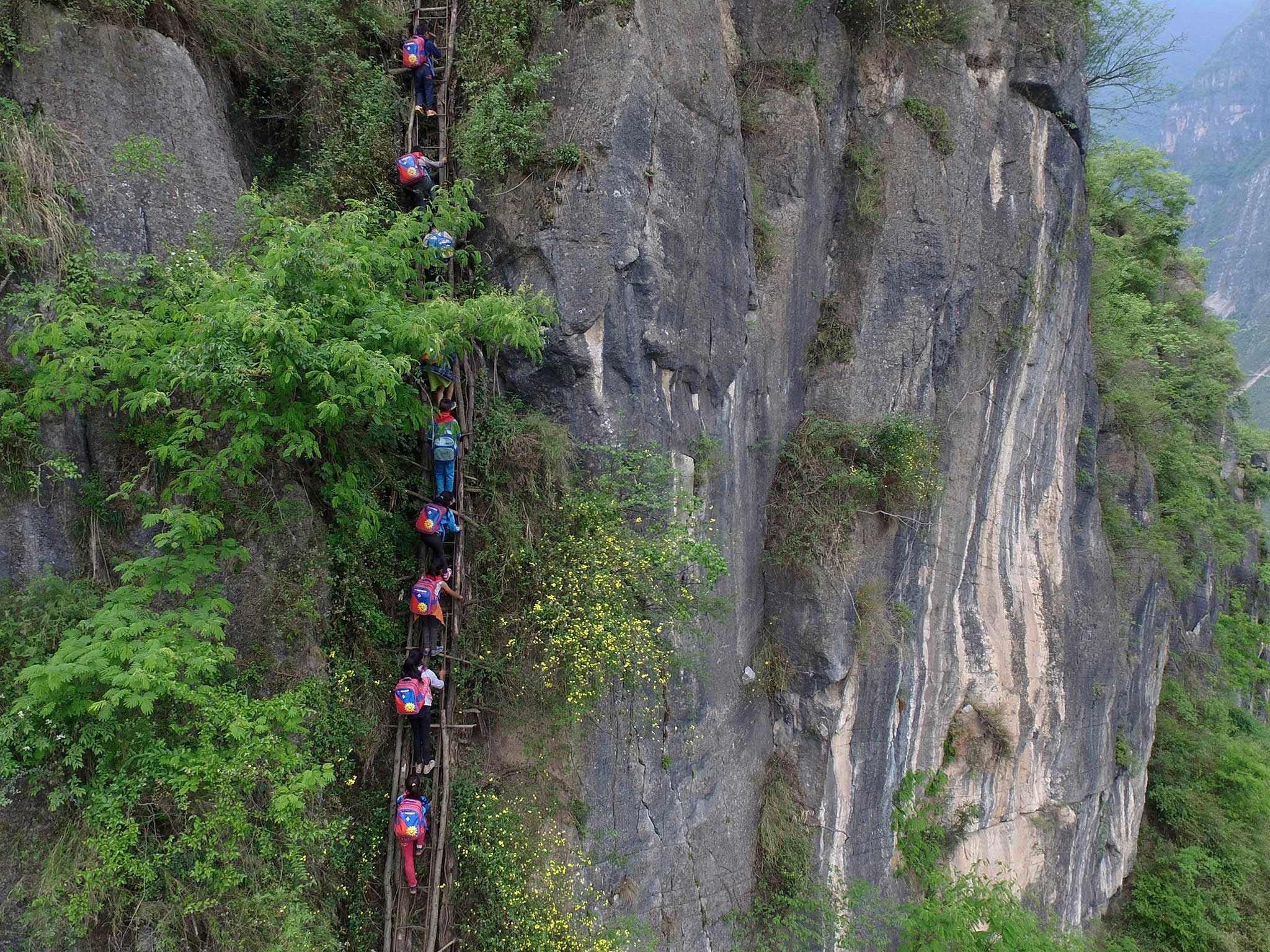 Children in China who climb 2,500 foot cliff to get to school may be given stairs