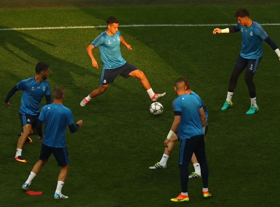 Real Madrid players warming up ahead of the Champions League final at the San Siro stadium in Milan