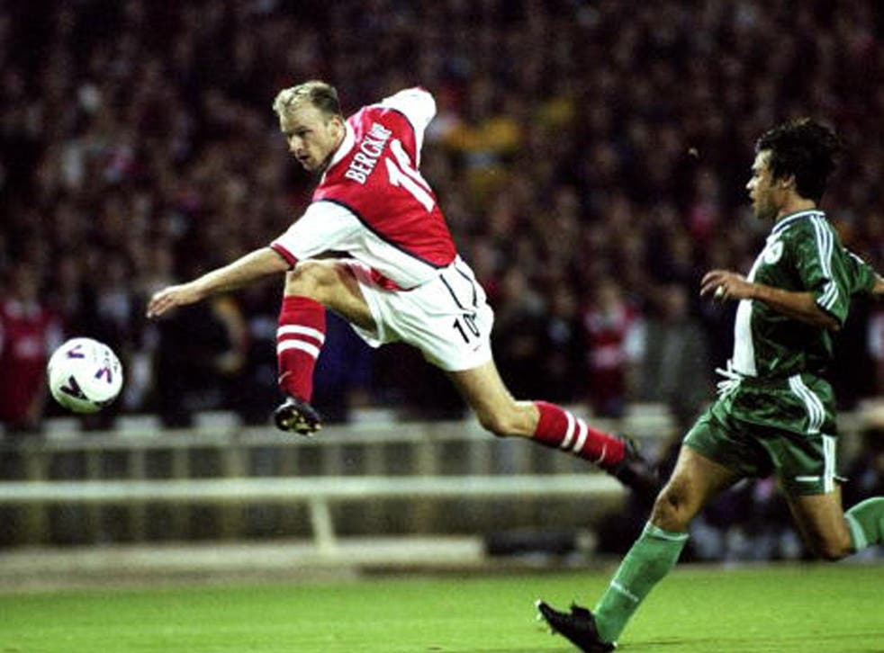 Dennis Bergkamp shoots for goal against Panathinaikos in Arsenal's first Champions League match at the old Wembley in 1998 (Getty)