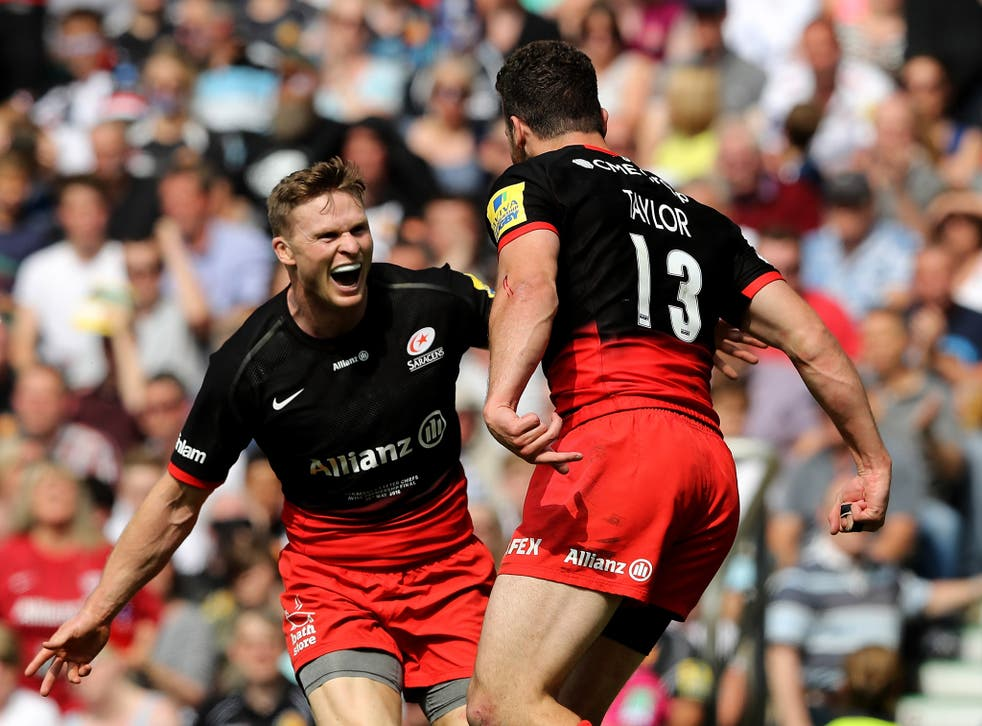 Duncan Taylor celebrates with Chris Ashton after scoring a try for Saracens