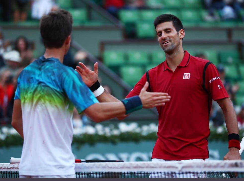 Novak Djokovic shakes hands with Aljaz Bedene following the world No 1's third round victory