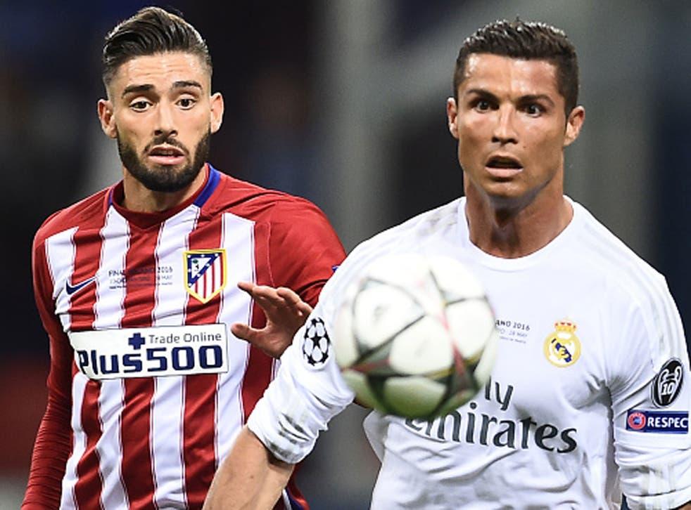 Atletico scorer Yannick Carrasco closes down Real Madrid's Cristiano Ronaldo during Saturday's Champions League final in Milan (Getty)