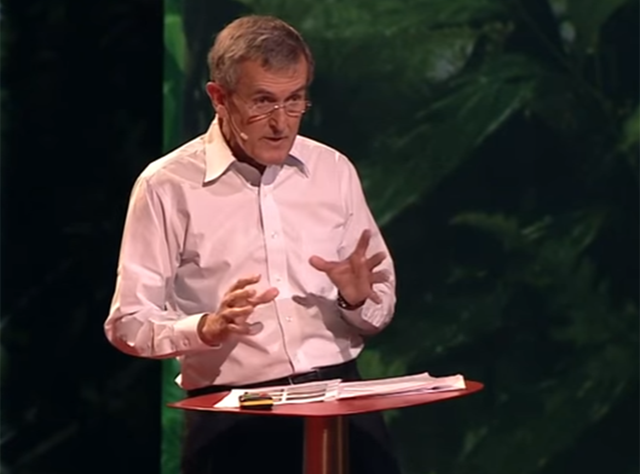 Neil MacGregor speaking at a TED talk in 2012
