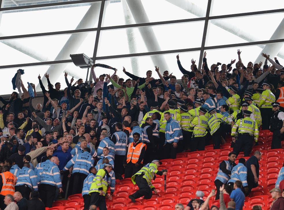 Millwall fans clash with police after attempting to charge the Barnsley fans