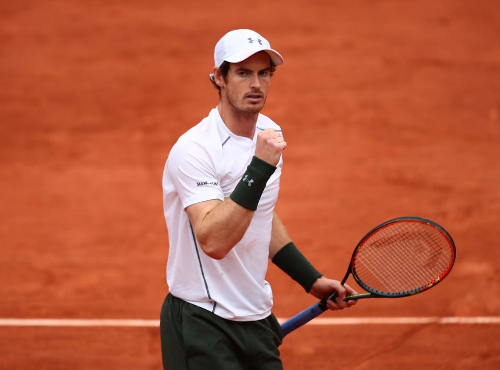 Andy Murray celebrates his French Open fourth round victory over John Isner