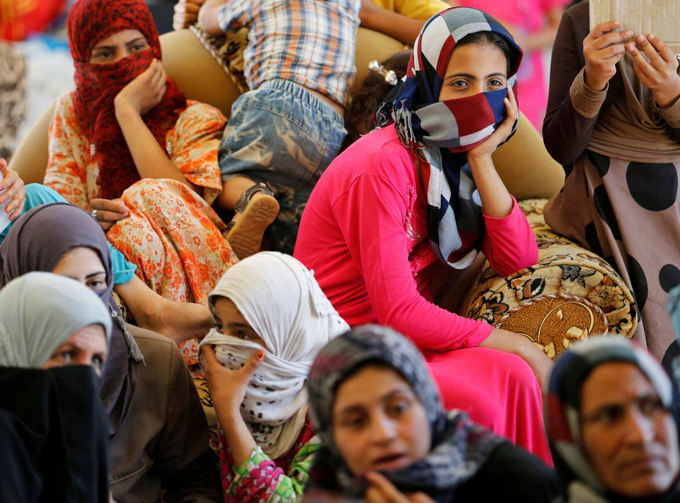 Civilians who fled their homes due to clashes on the outskirts of Fallujah, gather in the town of Garma, Iraq, on 30 May