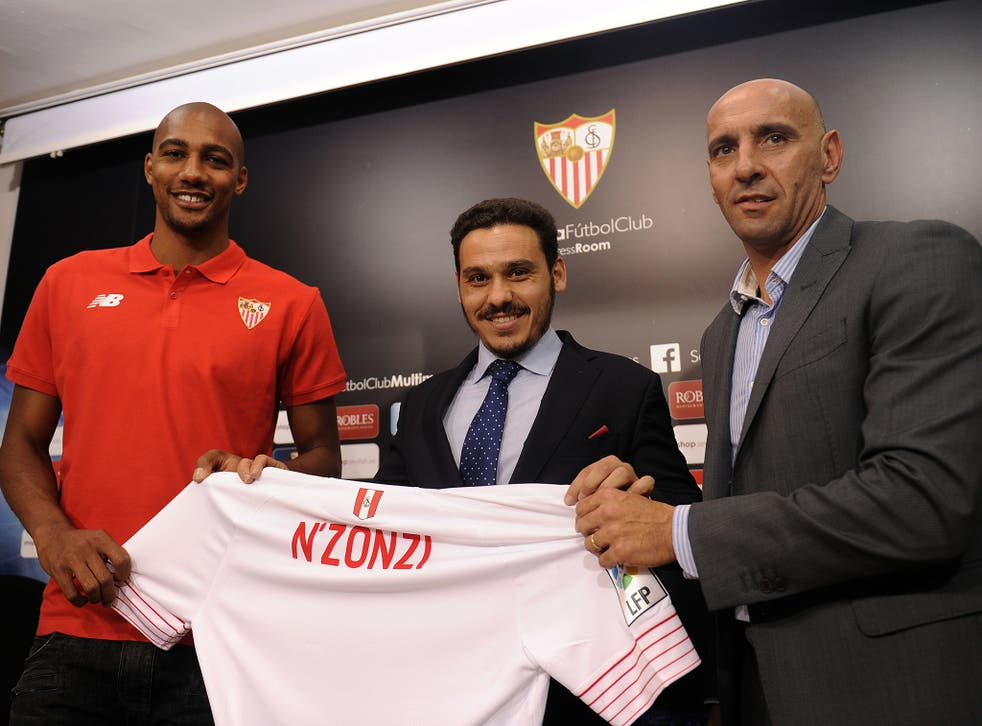 Monchi, right, unveils the signing of Steven N'Zonzi last summer