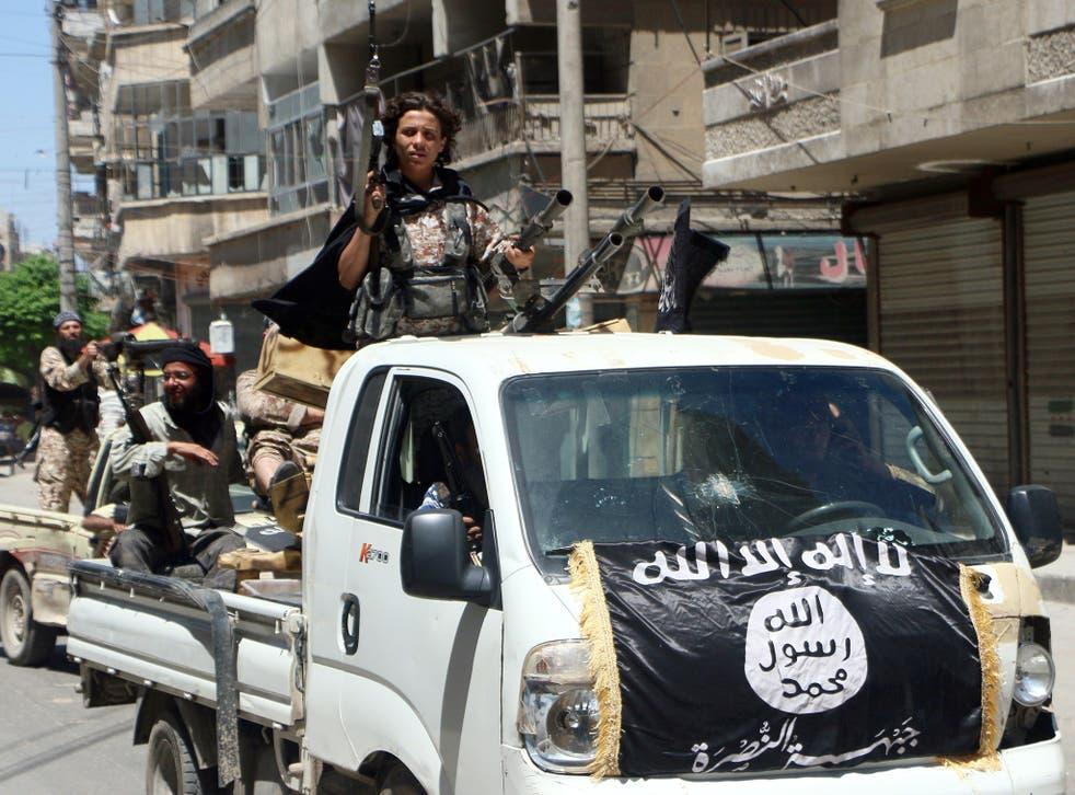 Jabhat al-Nusra fighters parading through Aleppo last year