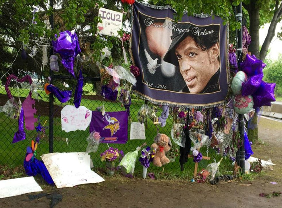 Fans have left tributes outside the musician's Minneapolis home