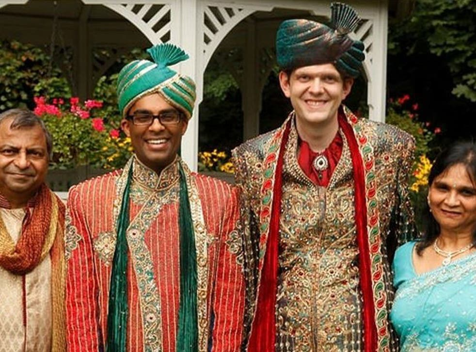 The couple with Rishi's parents at their traditional Hindu wedding