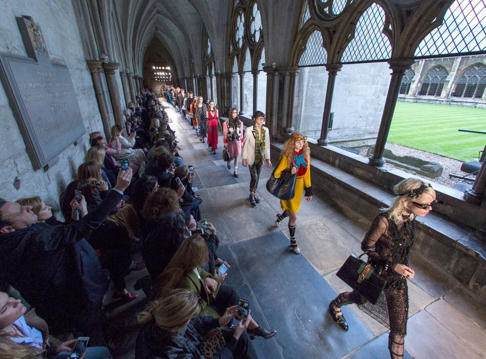 Models parade through the cloisters of Westminster Abbey for Gucci's latest Cruise show