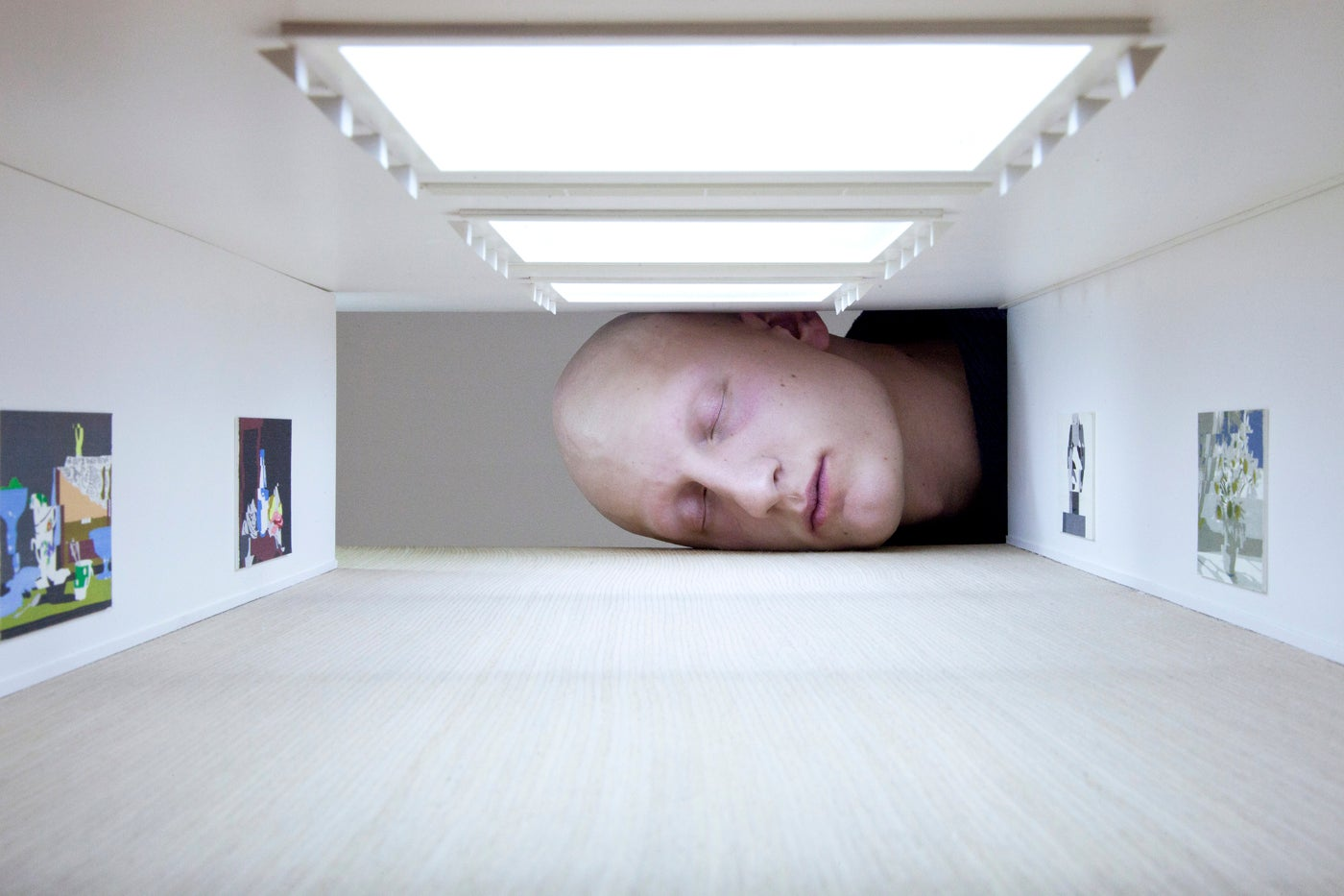 These giant heads installed in galleries will screw with how you perceive humans