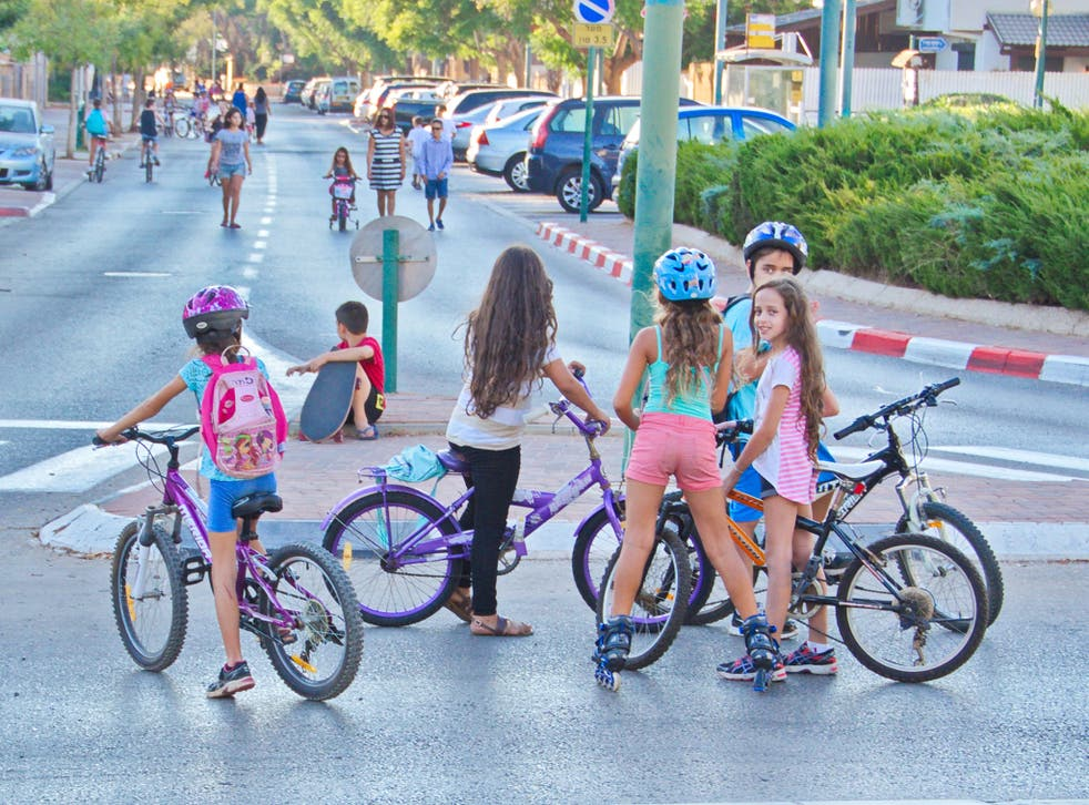 Young girls riding bikes in Israel (file pic)