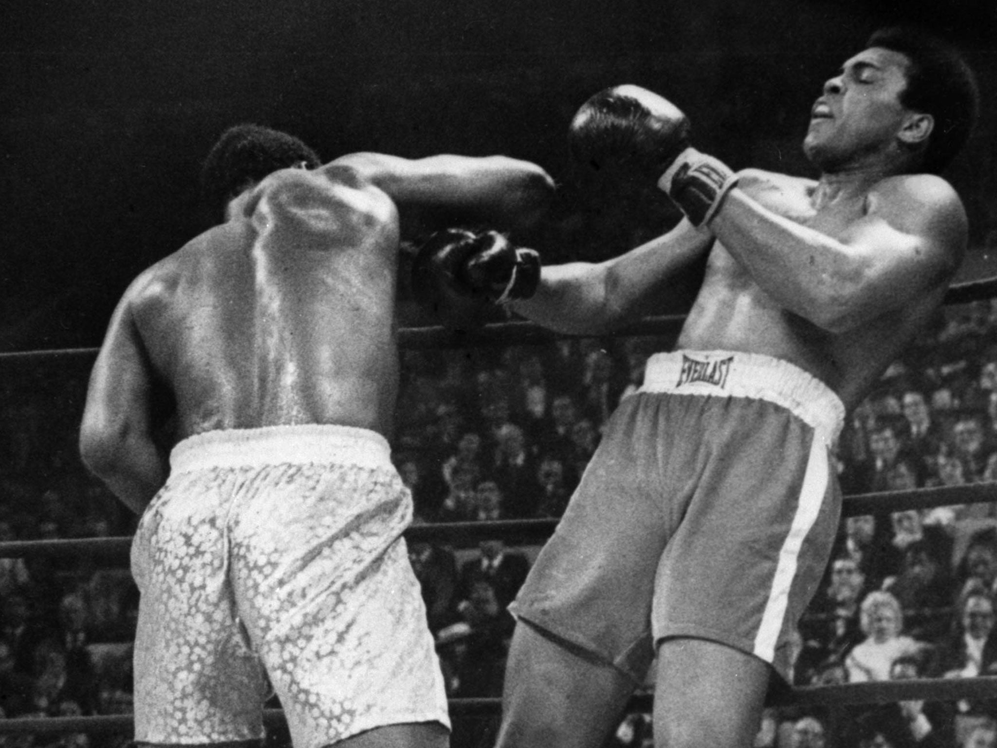 Joe Frazier L Fighting Against Muhammad Ali